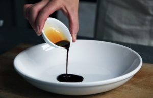 sauce being poured into bowl